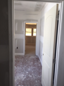 The hallway of a house, in which drywall has not yet been installed.